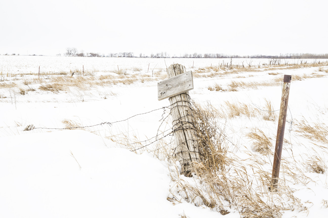 snowy field and barbed wire